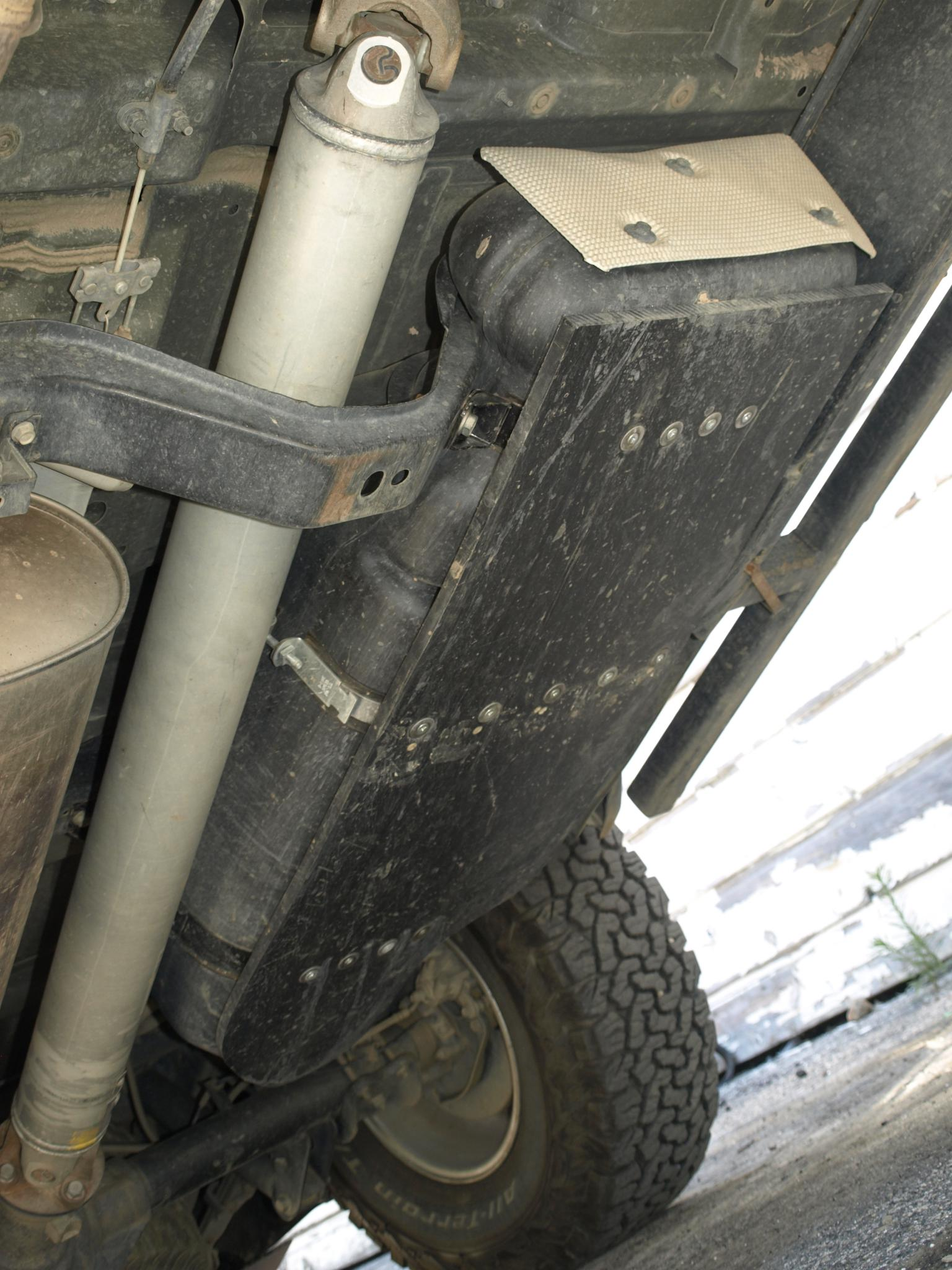... Click image for larger version Name _7250301.jpg Views 1197 Size 316.8 & Plastic Gas Tank Skid Plate - Nissan Frontier Forum