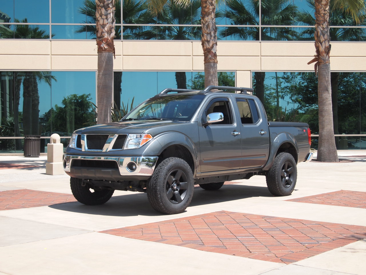 """rear, 2"""" body lift with 25mm wheel adapters, Titan OEM 18"""" wheels:"""